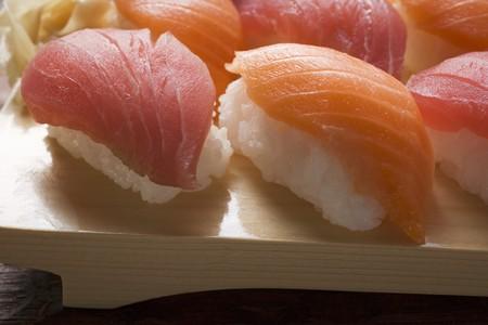 tunafish: Nigiri sushi with tuna and salmon on sushi board LANG_EVOIMAGES