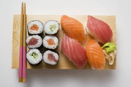 maki sushi: Maki sushi and nigiri sushi on sushi board LANG_EVOIMAGES