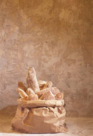 several breads: Assorted bread products in a paper sack LANG_EVOIMAGES