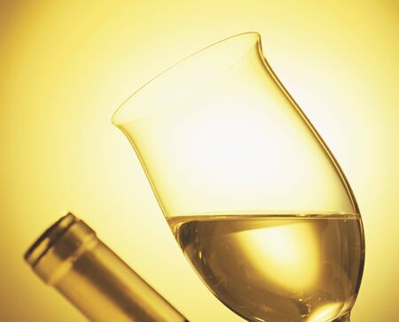bottleneck: Glass of white wine and bottleneck LANG_EVOIMAGES