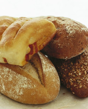 several breads: Rye bread, wholemeal bread, tomato bread & sourdough bread