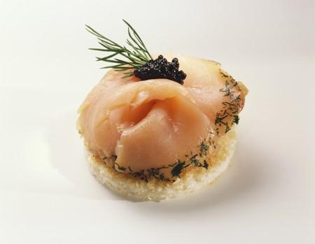 amuse: Canapé: gravlax and caviar on toast