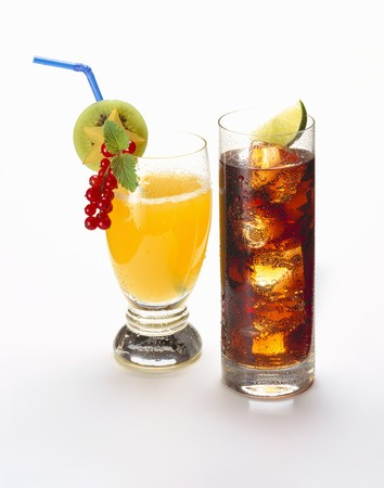 soda pops: Orangeade garnished with fruit, cola with ice cubes