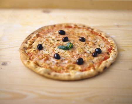 entire: Pizza with black olives, basil and oregano