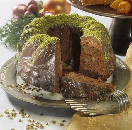 coatings: Chocolate-covered ginger cake with nuts, partly sliced