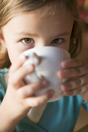slurp: Young girl drinking a cup of hot chocolate
