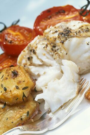 halibut: Halibut with fried potatoes and tomatoes