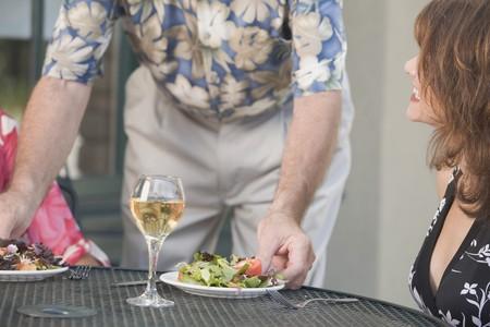 Man serving salad