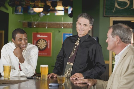 beer and necktie: Three men at the bar in a pub