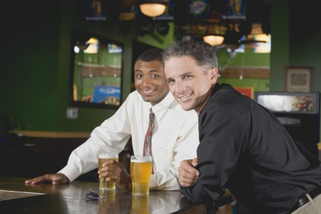 beer and necktie: Two men in a pub