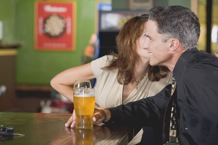 35 to 40 year olds: Man and woman at a bar