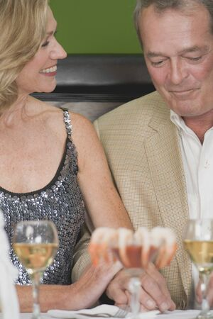 Mature couple with wine and shrimps in restaurant LANG_EVOIMAGES