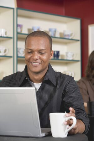 25 to 30 year olds: Young man at laptop in a caf�
