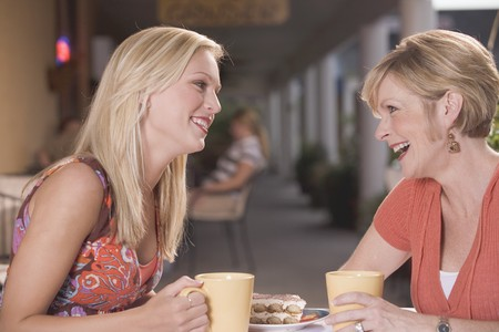 30 to 40 year old: Two women in a caf�