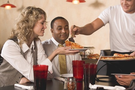 35 to 40 year olds: Man serving pizza to customers