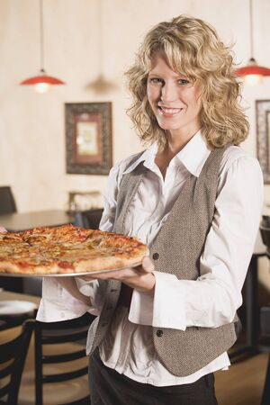 35 to 40 year olds: Blond woman holding a pizza