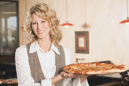 30 to 35 year olds: Blond woman holding a pizza