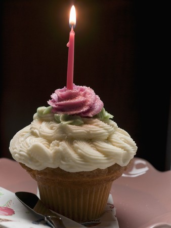 candlelit: A cupcake with a burning birthday candle