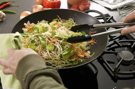 stirred: Vegetables in wok being stirred