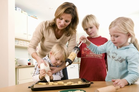 four year olds: Mother and children making piped biscuits