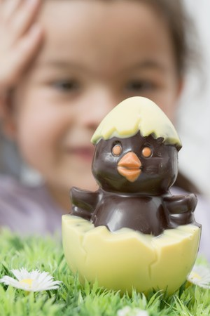 sweet grasses: A chocolate chick hatching out of an egg (Easter) LANG_EVOIMAGES
