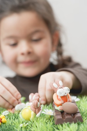sweet grasses: A girl playing with chocolate figures