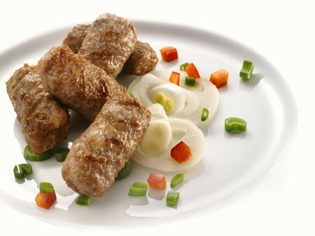 qs: Mince rolls, garnished with vegetables LANG_EVOIMAGES