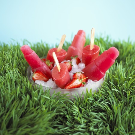 sweet grasses: Strawberry ice lollies in a bowl of ice cubes