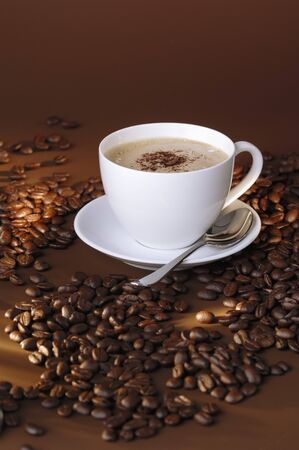 brownness: A cup of coffee and coffee beans LANG_EVOIMAGES