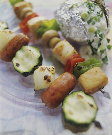 qs: Two kebabs: sausage & vegetable and chicken & vegetable