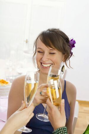 18 25 year old: Young woman drinking champagne LANG_EVOIMAGES