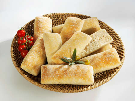 several breads: Ciabatta rolls in a bread basket LANG_EVOIMAGES