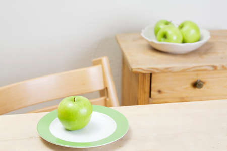 granny smith apple: Granny Smith apple on a plate