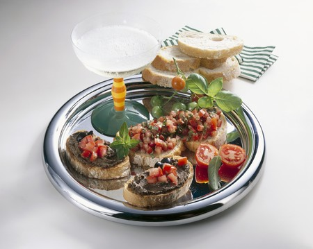 pastes: Crostini with tomatoes & olive paste & glass of sparkling wine