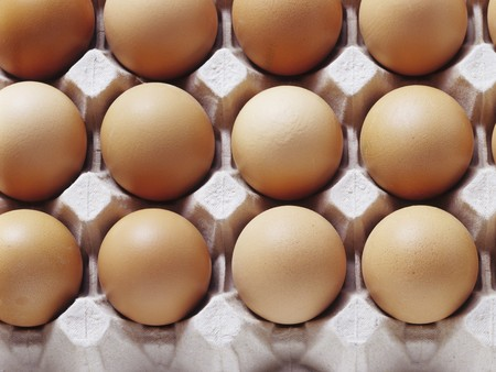 brownness: Brown eggs in an egg tray