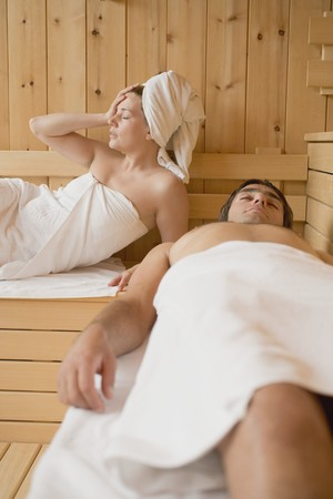 35 to 40 year olds: Man and woman lying in a sauna
