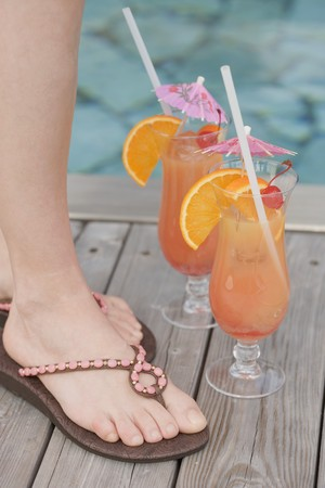 planters: Two cocktails (Planters Punch) by pool