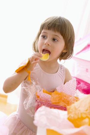 childs birthday party: Little girl eating sweets