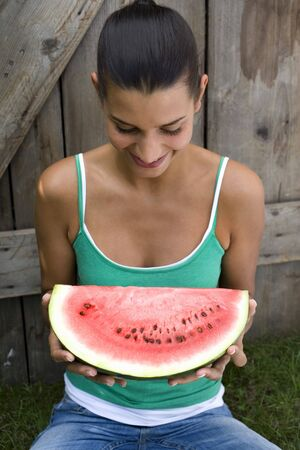 18 25 year old: Young woman with slice of watermelon
