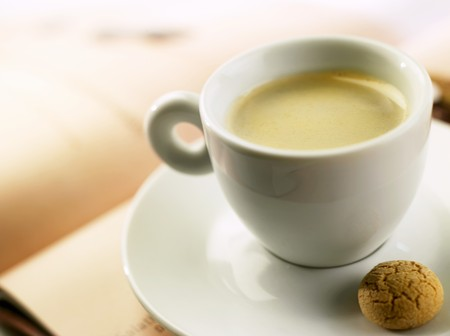almond biscuit: A cup of espresso with almond biscuit
