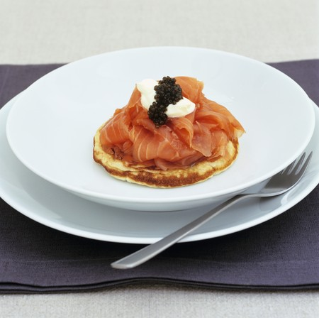 blini: Smoked salmon with sour cream and caviar on blini