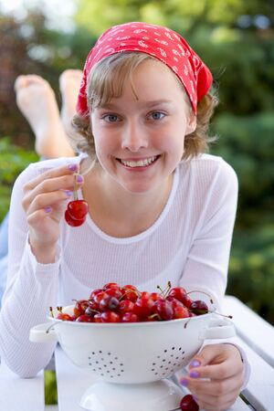 16 year old girls: Girl with cherries in garden