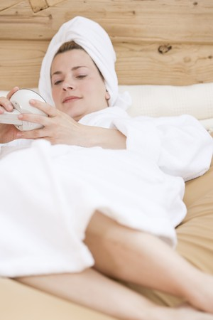 35 to 40 year olds: Woman in bathrobe relaxing