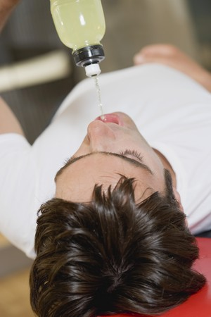 body consciousness: Young man drinking fitness drink during workout