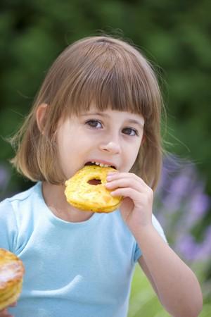 fritter: Girl eating an apple fritter