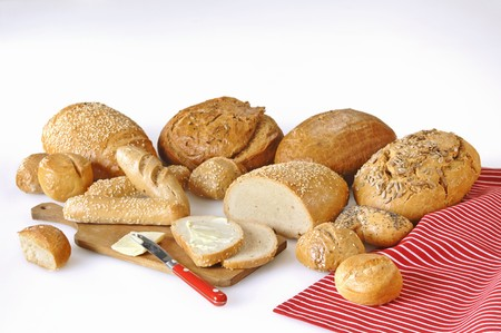 several breads: A variety of breads and rolls with butter LANG_EVOIMAGES
