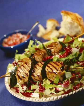coquille: Grilled scallop kebabs on a bed of salad