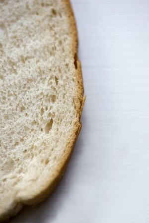 pain blanc: Partie d'une tranche de pain blanc LANG_EVOIMAGES