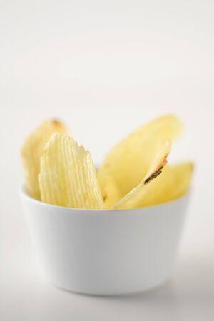 nibbles: Potato crisps in bowls LANG_EVOIMAGES