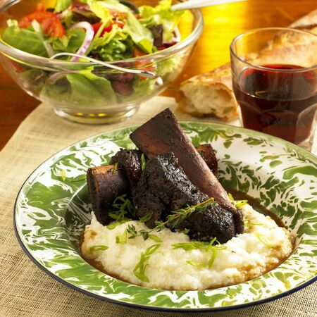 jus: Grilled Short Ribs Over Polenta with Au Jus Sauce; Salad and Red Wine LANG_EVOIMAGES